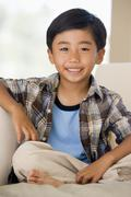 Young Buy Sitting On A Sofa At Home Stock Photos