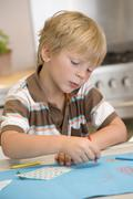 Young Boy Drawing Pictures - stock photo