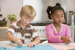 Two Young Friends Drawing Pictures - stock photo
