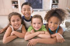 Four Young Friends Hanging Out At Home - stock photo