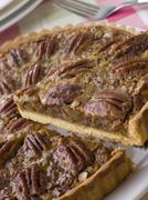 Pecan Pie With A Slice Being Cut Stock Photos