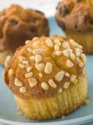 Lemon Meringue, Blueberry And Chocolate Chip Muffins - stock photo