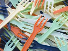 Pile Of Coloured Plastic Take Away Forks - stock photo