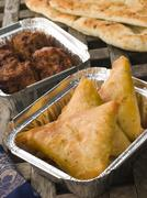 Indian Take Away- Vegetable Samosa, Naan Bread And Onion Bahji - stock photo