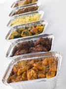 Selection Of Indian Take Away Dishes In Foil Containers Stock Photos