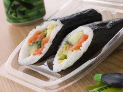 Hand Moulded Sushi With A Can Of Green Tea Stock Photos