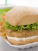 Southern Fried Chicken Fillet Burger With Fries And A Soft Drink - stock photo
