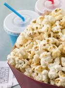 Bucket Of Popcorn With Soft Drinks And Cinema Tickets Stock Photos