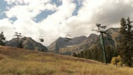 Sightseers on chairlift in autumn Stock Footage
