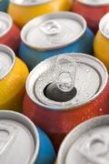 Close Up Of Multi Colored Soda Cans With One Open Stock Photos