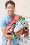 Man doing laundry Stock Photos