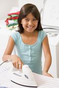 Young girl ironing Stock Photos