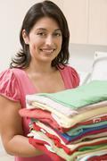 woman holding fresh laundry - stock photo