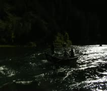 Flyfishing drift boat passes camera Stock Footage