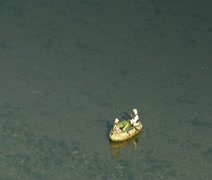 super zoom out shot of flyfishing drift boat and River - stock footage