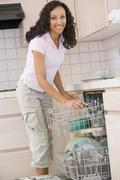 Woman loading dishwasher Stock Photos