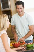 Stock Photo of husband and wife preparing dinner