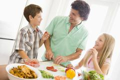 Father and children prepare a meal,mealtime together Stock Photos
