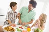 Stock Photo of father and children prepare a meal,mealtime together