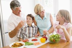 Stock Photo of grandparents and grandchildren prepare a meal,mealtime together