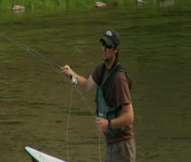 Pullout from fly fishermen to wide shot of River Stock Footage