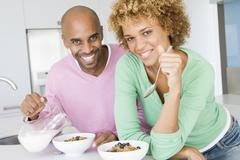 Husband and wife eating breakfast together Stock Photos