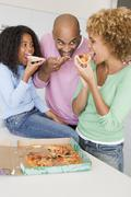 Family eating pizza together Stock Photos