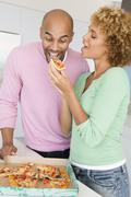 husband and wife eating pizza - stock photo