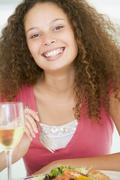 woman eating meal,mealtime with a glass of wine - stock photo