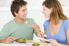 Young couple enjoying meal,mealtime together Stock Photos