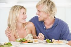 young couple enjoying meal,mealtime together - stock photo