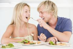 Stock Photo of young couple enjoying meal,mealtime together