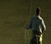 Fly fisherman lets line drift Stock Footage