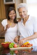 Stock Photo of mother and daughter preparing meal,mealtime together