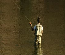 Young man flyfishing in colorful water Stock Footage