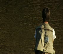 Tight shot on young man flyfishing with drifting line Stock Footage