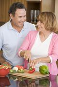 Husband and wife preparing meal,mealtime together Stock Photos