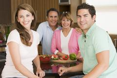 Stock Photo of family preparing meal,mealtime together