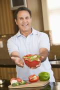 man presenting salad - stock photo