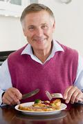 Man enjoying healthy meal,mealtime Stock Photos