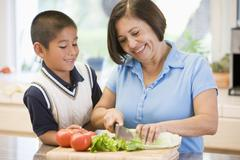 Stock Photo of grandmother and grandson preparing meal,mealtime together