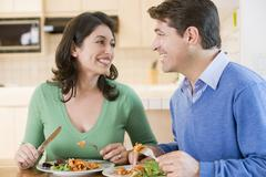 Couple enjoying meal,mealtime together Stock Photos