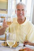 man enjoying meal,mealtime with a glass of wine - stock photo