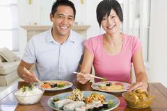 Stock Photo of young couple enjoying chinese food