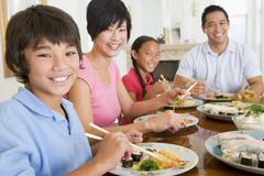Stock Photo of family eating a meal,mealtime together
