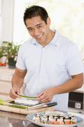 man preparing sushi - stock photo