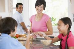 family in the kitchen eating breakfast - stock photo
