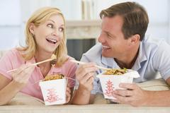 Couple eating takeaway meal,mealtime together Stock Photos