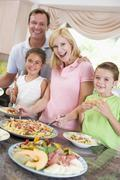 Mother serving up dinner for family Stock Photos