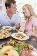 Stock Photo of couple enjoying meal,mealtime together